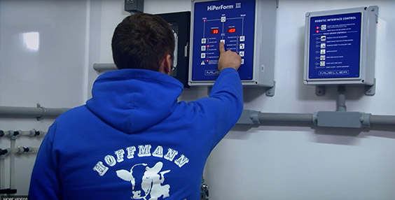 Hoffman Dairy Farm worker using Robotic Interface Controls