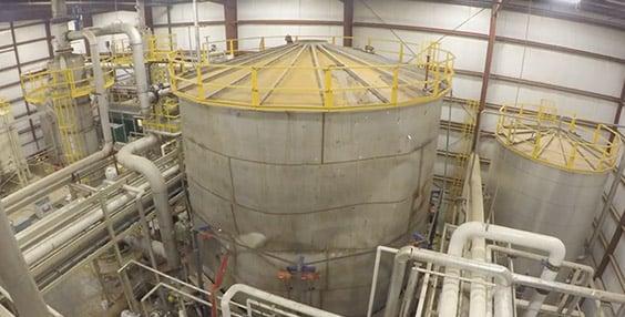 Large imploded tank inside facility