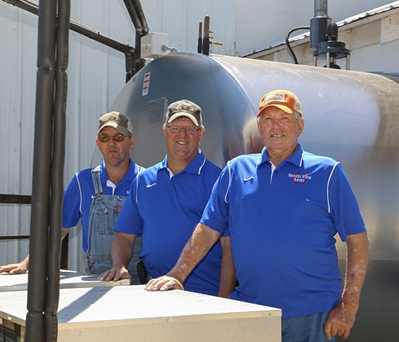 Farmers with Stainless Steal Tanks
