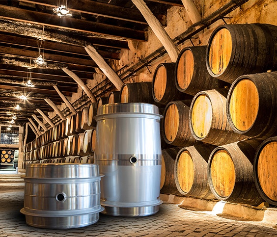 Steel Wine Barrels Contrasted Against Wood Wine Barrel