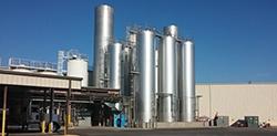 Raw milk silo storage tanks outside processing plant