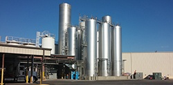 Raw milk silo storage tanks outside processing plant