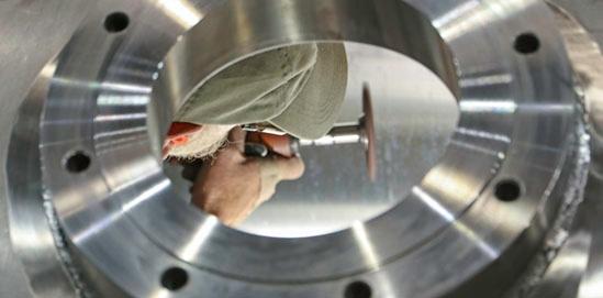 A grinder working inside a tank